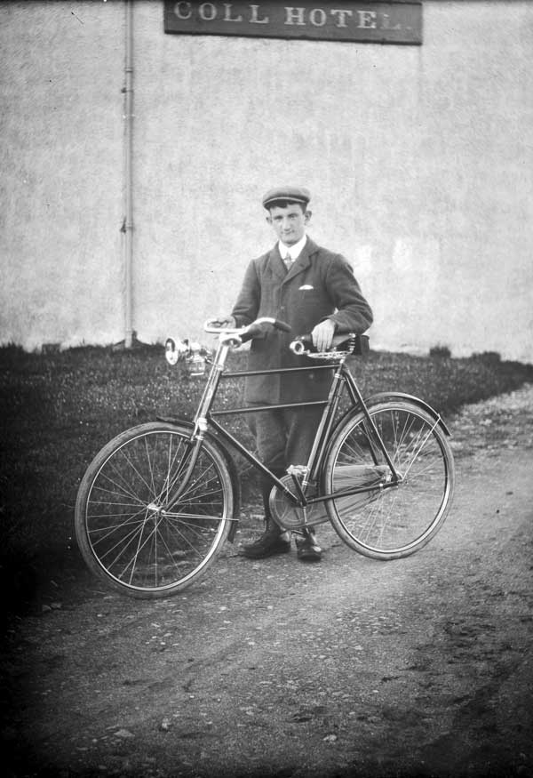 Cyclist outside Coll Hotel