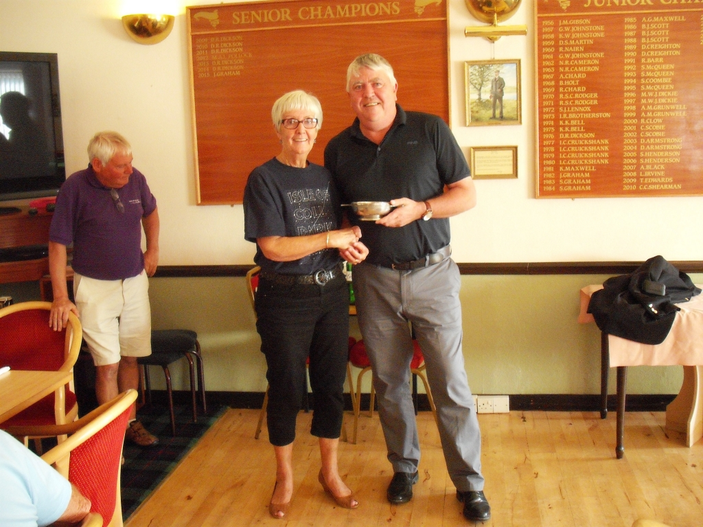 Austin Black of the Coll Team presented with the David and Sadie Moore Quaich by Mrs Margaret Thorburn